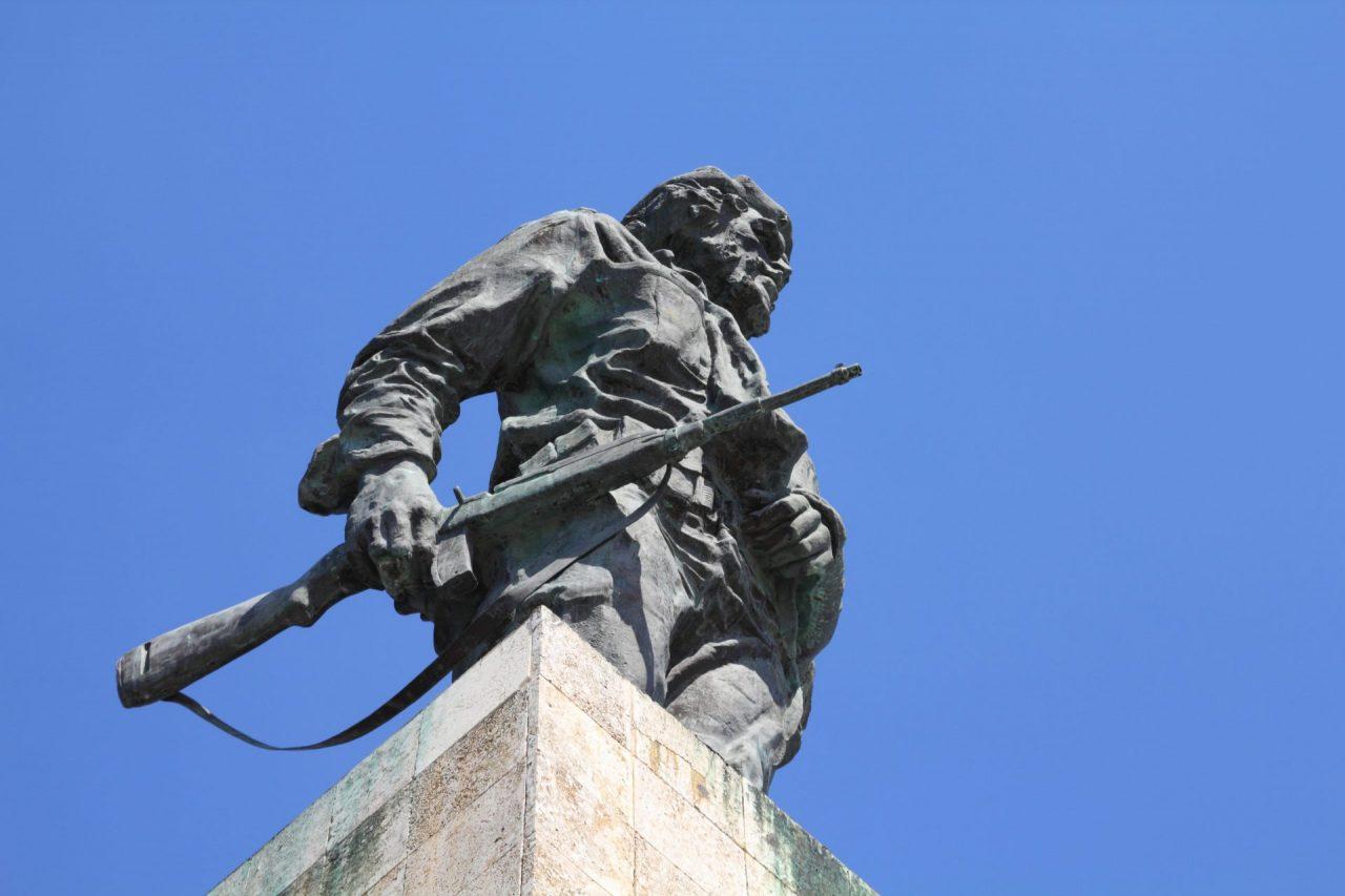 Che Guevara holding a rifle in Santa Clara, Cuba. Symbol of revolution.